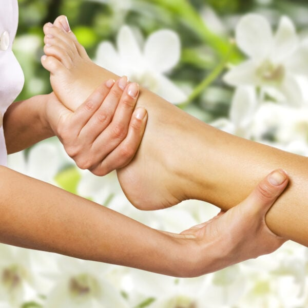 Foot massage in the spa salon in the garden.
